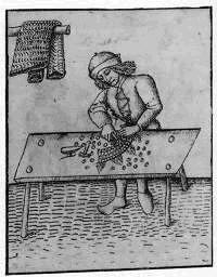 Een middeleeuwse smid aan het 'weven'.
